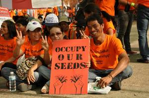 September 2013 protest against FTAs: in Thailand, popular movements are resisting the possibility that talks over a free trade agreement between Thailand and the EU will result in UPOV being imposed on the nation's farmers. (Photo: FTA Watch)