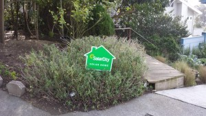Photo courtesy of Jeff Leeds A SOLARCITY HOME: The front of Jeff Leeds house had this small promotional sign in 2012 after Leeds said he bought into a sales pitch.