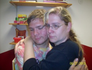 Kathy hugs her son goodbye at their final visit. Source: Butner family.