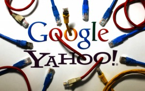 An illustration picture shows the logos of Google and Yahoo connected with LAN cables in a Berlin office, October 31, 2013. REUTERS/Pawel Kopczynski​